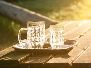 Glass jugs empty in the sunset