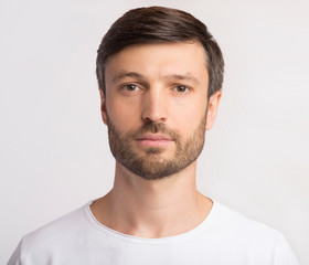 Portrait Of Man Looking At Camera Over White Background