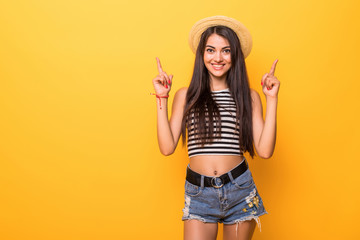 Young pretty woman pointed up isolated on orange background