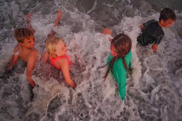 Children being hit being hit by wave on Myrtle Beach