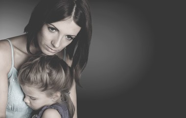 Portrait  of sad Mother with daughter