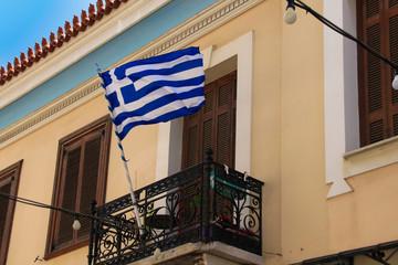 A traditional greek balcony with a greek national flag. Athens - Greece