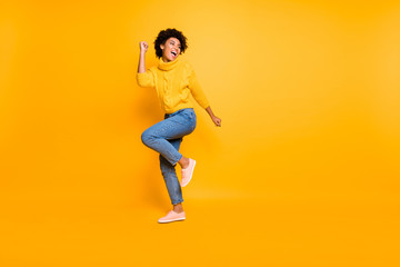 Full length body size view of her she nice attractive cheerful cheery content successful wavy-haired girl having fun free time rejoicing isolated on bright vivid shine vibrant yellow color background