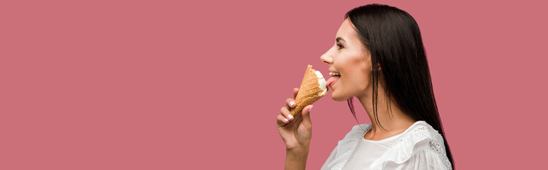 panoramic shot of happy woman eating tasty ice cream isolated on pink Wall mural