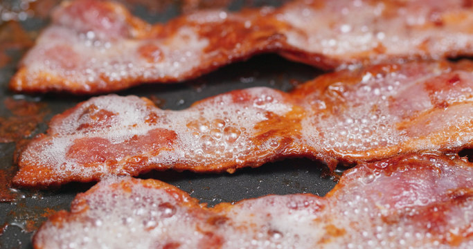 Fry bacon on a pan