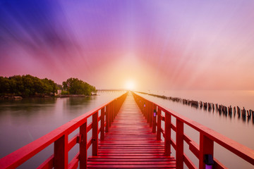 Foto op Plexiglas Zalm Long Red Bridge sunlight sky tree at beach sea,Red bridge Samut Sakhon Thailand