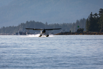 Seaplane landing in the harbor in Ketchikan, Alaska.