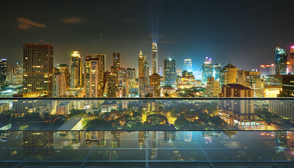 Empty transparent glass floor on rooftop with city skyline