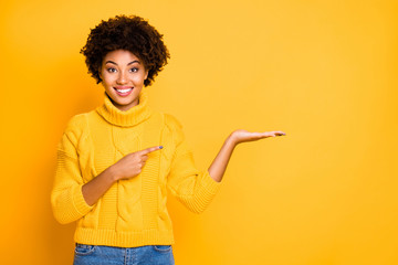 Photo of pretty dark skin lady promoter holding on arm best product for final low price wear warm jumper isolated yellow background