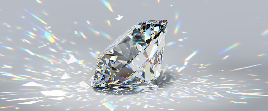 Round cut diamond on white background with colorful caustics rays.