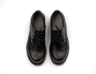 Mens black shoes isolated on a white background.  Top view
