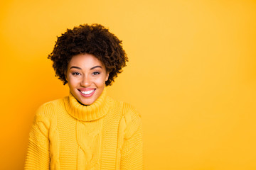 Photo of amazing dark skin lady with sweet beaming smile wear warm knitted jumper isolated yellow background Fototapete
