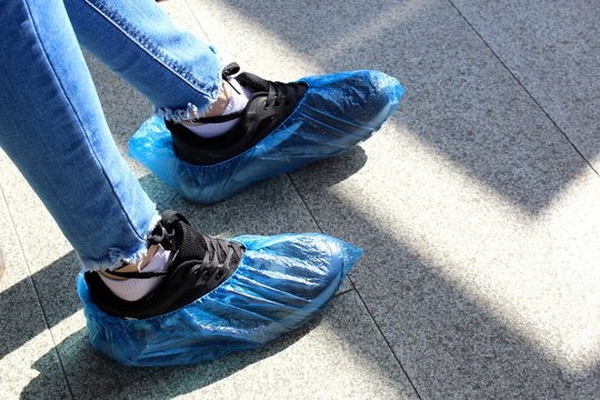 blue disposable shoe covers are worn on the upper shoes