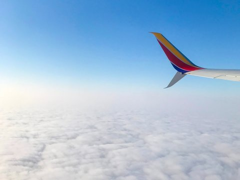 Southwest Airlines Airplane Wingtip over Blue Sky and Clouds