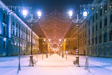 Russia. Saint-Petersburg. The street is decorated for Christmas. Christmas decorations of the city. Colorful garlands on the streets of St. Petersburg. Festive city. Travel to Russia. Fotomurales
