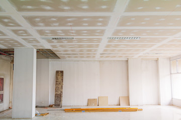 gypsum board ceiling structure and plaster mortar wall painted foundation white decorate interior room in building construction site