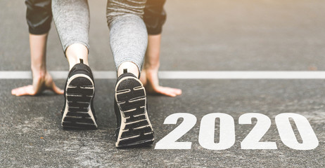 Woman in sports uniform running around. Healthy way of life, an infused figure. sneakers close-up, finish 2019. Start to new year 2020 plans, goals, objectives