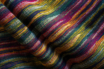 Texture of motley striped fabric closeup. Tapestry background