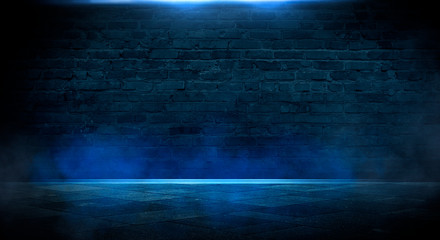 Fotomurales - Blue dark background of empty foggy street with wet asphalt, illuminated by a searchlight, laser beams, smoke