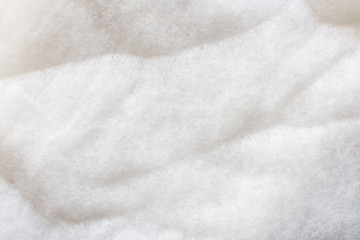 The texture of a white padding polyester. Syntepon- insulation material for clothes Fototapete