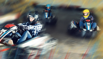 Young people driving sport cars for karting Wall mural