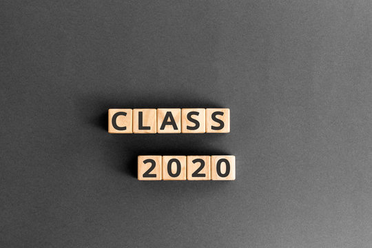 Class 2020- word from wooden blocks with letters, Class of 2020 concept, grey background