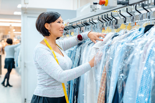 Small business owner woman in a textile cleaning shop