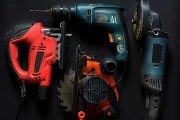 Hand power tools on a black background close-up.
