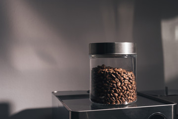 Fresh whole coffee beans in a glass  jar