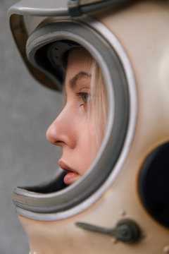 Close-up of woman in space helmet