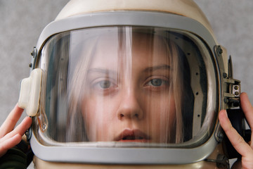 Sensual girl wearing retro space helmet