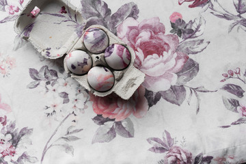 Eggs in egg holder on floral fabric