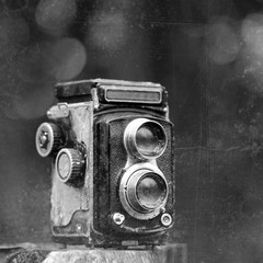Grungy b&w photo of dirty old camera
