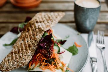 Sandwich with rocket, onion, and whole grain dijon mustard