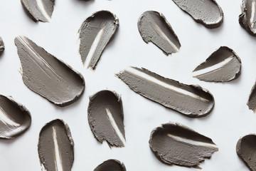 Strokes of mud mask on white background.
