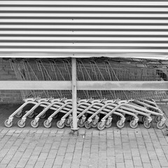 Row of shopping carts outside a mall