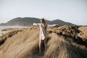 Girl dancing on grassland