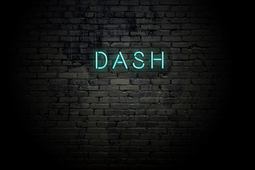 Highlighted brick wall with neon inscription dash