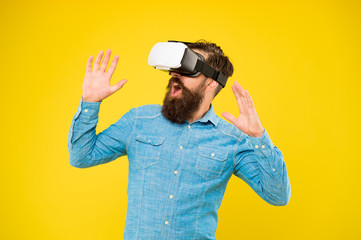 The game is on. Hipster play video game. Bearded man explore VR yellow background. Game developer...
