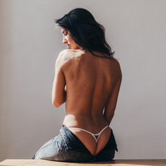 Back view of naked back young woman
