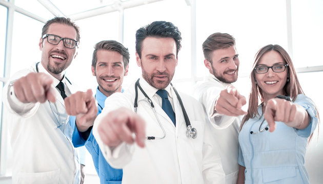 Portrait of doctors pointing at you