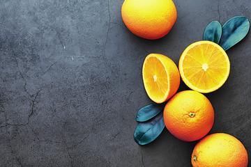Orange citrus fruit on a stone table. Orange background. Wall mural