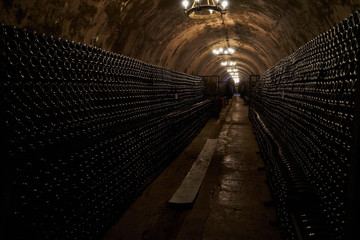 An image of an underground tunnel for aging wine.