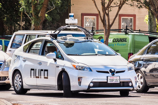 Sep 17, 2019 Mountain View / CA / USA - Nuro autonomous vehicle driving on a street in Silicon Valley; Nuro is a robotics company founded by two ex Waymo (Google self driving car project) engineers
