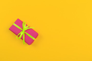 Gift box with ribbon and bow on color background and space for text. Top view - Image