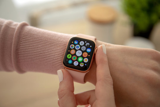Woman hand with Apple Watch Series 4 finger touching screen