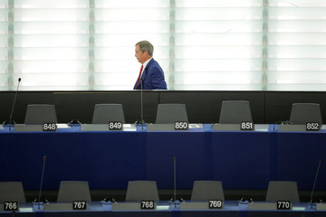 Brexit Party leader Nigel Farage leaves the plenary during a debate on Brexit at the European Parliament in Strasbourg