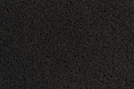 abstract dark black foam rubber texture, macro view, protection textured surface