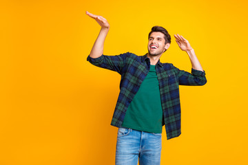 Photo of nice guy crazy dancer inviting friends to dance floor wear casual plaid shirt isolated yellow color background