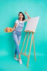 Vertical full length body size view of her she nice attractive cheerful cheery wavy-haired girl wearing casual drawing collage water color isolated on bright vivid shine green turquoise background